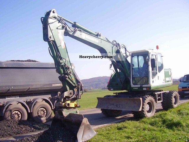 2002 Atlas  1404M Engcon rotator Construction machine Mobile digger photo
