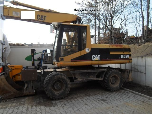 1997 CAT  M 320 Construction machine Mobile digger photo
