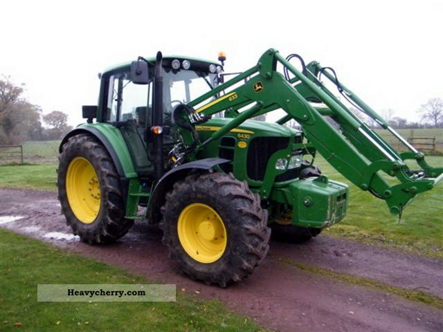 2010 John Deere  6430 Agricultural vehicle Tractor photo