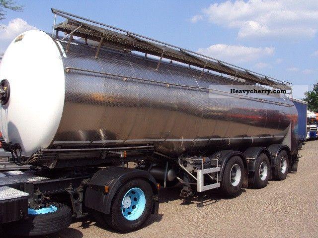 2004 Magyar  34 000 liters min pomp 900ltr tridec Semi-trailer Tank body photo
