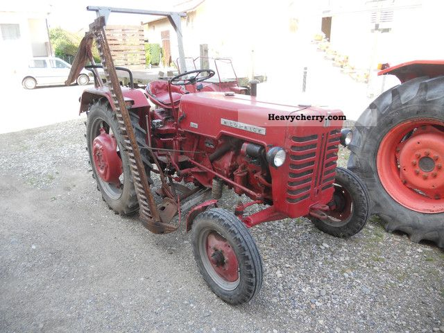 1962 McCormick  326 with Mährwerk Agricultural vehicle Tractor photo