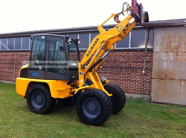 1999 Ahlmann  AL 75 4x4 front bucket Silent Construction machine Wheeled loader photo