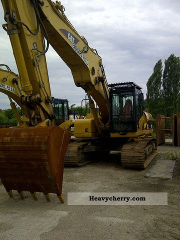 2012 CAT  325 DL Construction machine Caterpillar digger photo