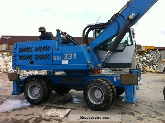 2010 Fuchs  MHL331D Construction machine Mobile digger photo