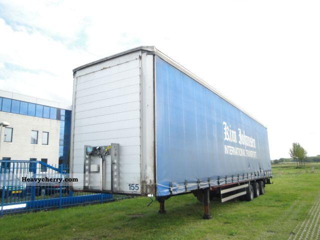 2003 Talson  3-axle trailer Mega Semi-trailer Stake body and tarpaulin photo