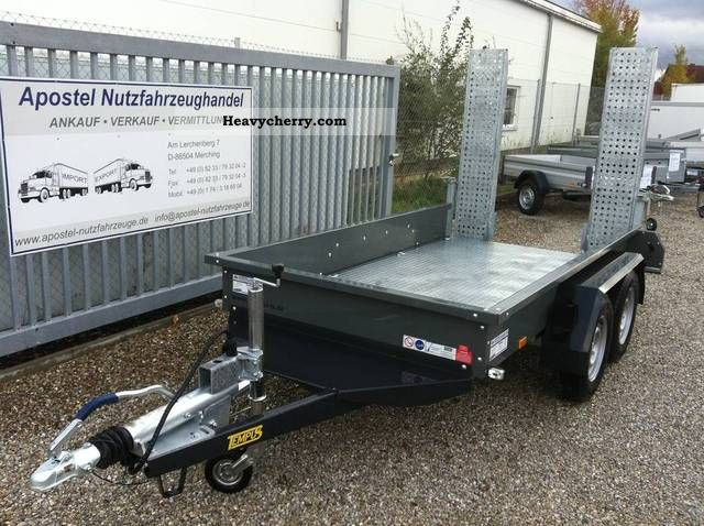 how to build trailer ramps to load a bobcat machine
