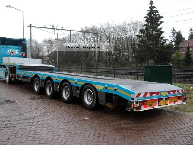 2012 Broshuis  4-axis 2x telescopic semilowloader Semi-trailer Low loader photo