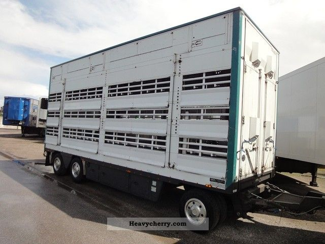 2004 Pezzaioli  RBA31 3 Stock, Retractable roof, own Ag Trailer Cattle truck photo
