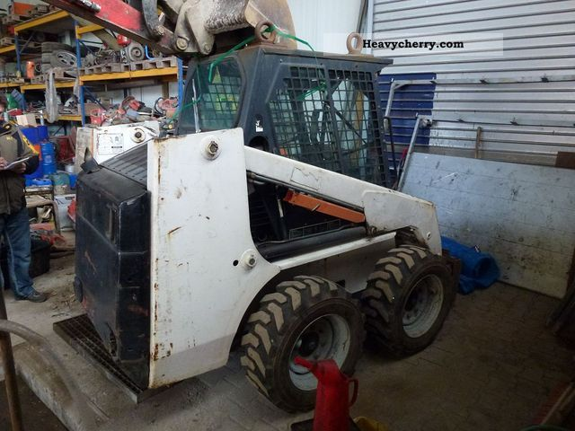 Bobcat 753 + fork slider 1998 Construction Equipment Photo and Specs