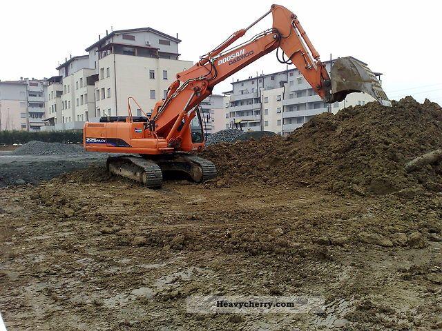 2012 Doosan  225 escavatore cingolato. anno 2006 ore 4800 Construction machine Combined Dredger Loader photo