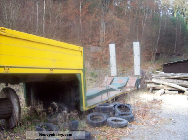 1990 Dinkel  Low bed trailer for forest machines Semi-trailer Low loader photo