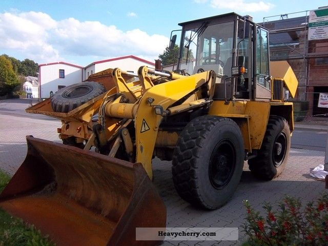 2000 Ahlmann  AS 14 Schwenklader first Hand and 3 attachments Construction machine Wheeled loader photo